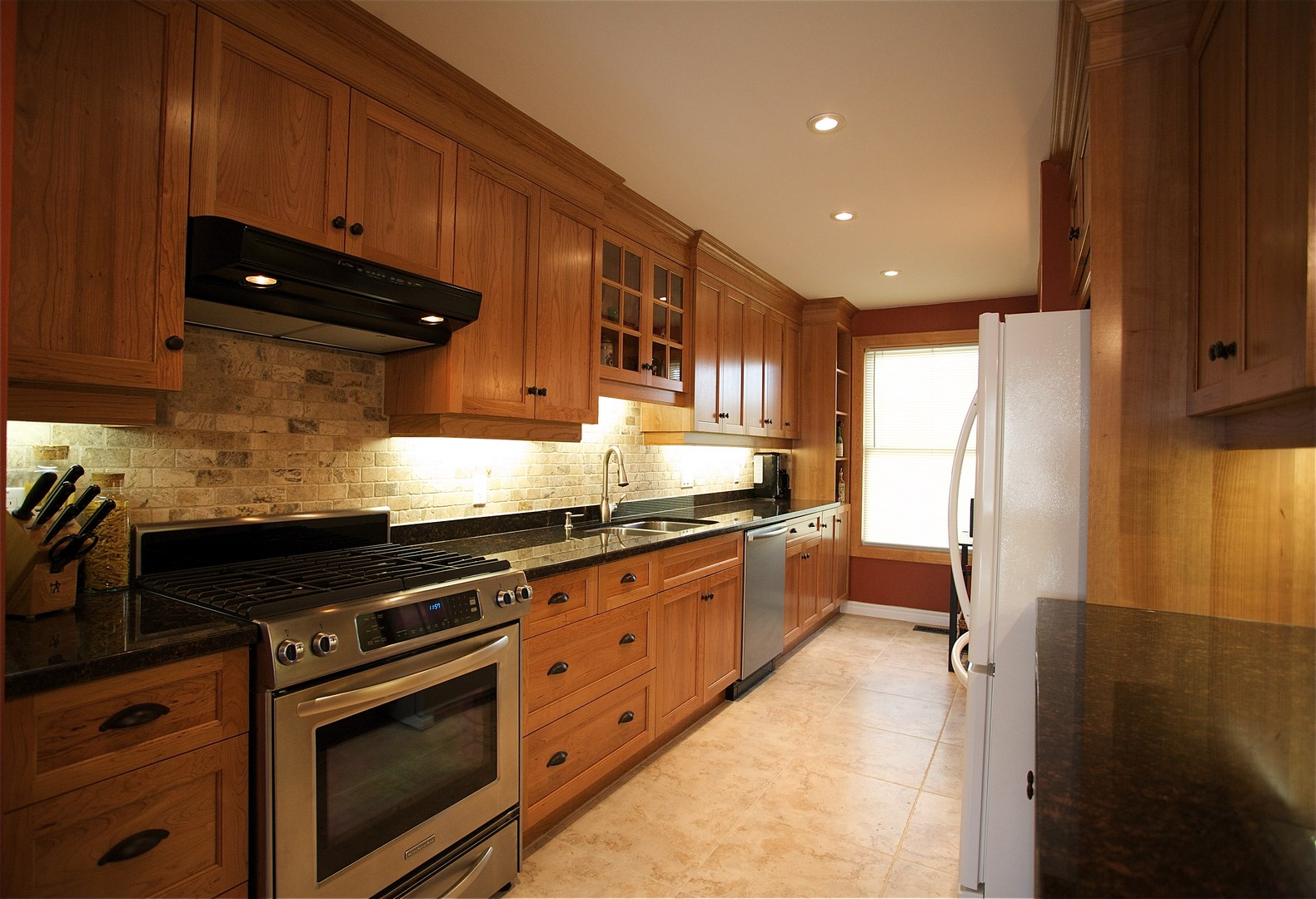 European Frameless Style Kitchen Cabinetry In Natural